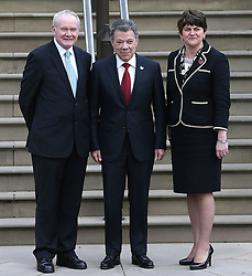 Colombia's president Juan Manuel Santos (centre) with First Minister Arlene Foster (right) and Deputy First Minister Martin McGuinness on arrival at Stormont Castle, Belfast, during a state visit.