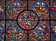Medieval stained glass Window of the Gothic Cathedral of Chartres, France - dedicated to the Life of St Lubin . Central panel shows A barrel of wine being transported to the Cathedral, below left - The young Lubin working as a shepherd, below right - A monk gives Lubin a belt with the alphabet written on it, above left - Lubin receiving instruction from a cleric, above right - Lubin spends his spare time learning to read, while his companion idles.  A UNESCO World Heritage Site.. .<br /> <br /> Visit our MEDIEVAL ART PHOTO COLLECTIONS for more   photos  to download or buy as prints https://funkystock.photoshelter.com/gallery-collection/Medieval-Middle-Ages-Art-Artefacts-Antiquities-Pictures-Images-of/C0000YpKXiAHnG2k