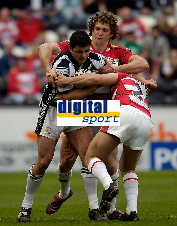 Photo: Jed Wee.<br /> Hull v Wigan Warriors. Engage Super League. 30/04/2006.<br /> <br /> Hull's Shayne McMenemy (L) is tackled.