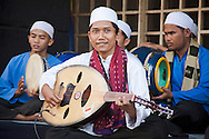 A traditional Indonesian music group on a street in Jakarta.<br /> Various scenes of the city of Jakarta in Indonesia.
