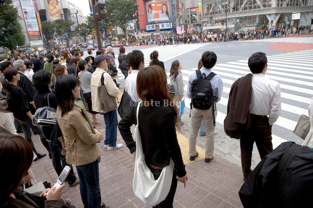 people waiting to cross the big Hachiko intersection at Shibuya station