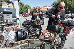 Utahans Rick Salisbury and Kyle Rose of Utah fuel their 1916 Excelsiors during the Motorcycle Cannonball Race of the Century. Stage-8 from Wichita, KS to Dodge City, KS. USA. Saturday September 17, 2016. Photography ©2016 Michael Lichter.