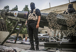 October 4, 2018 - Gaza City, Palestine - A military officer seen standing in front of a Gazan local made rocket during the parade..Members of the Palestinian Al-Quds Brigades, the military wing of the Islamic Jihad group march in the streets of Gaza city with their weapons to show loyalty for the Iranian-backed Palestinian movement's newly elected leader Ziad al-Nakhalah. (Credit Image: © Nidal Alwaheidi/SOPA Images via ZUMA Wire)