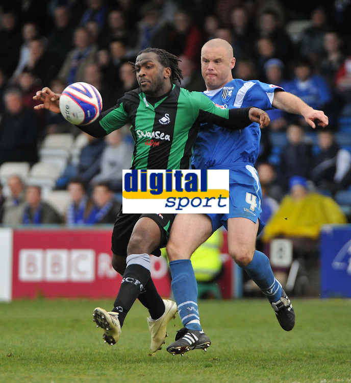 Photo: Tony Oudot/Richard Lane Photography. <br /> Gilingham Town v Swansea City. Coca-Cola League One. 12/04/2008. <br /> Jason Scotland of Swansea fends off a challenge from Danny Cullip of Gillingham