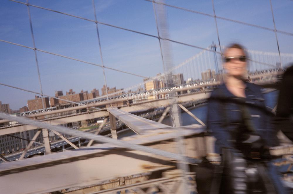 A tourist on the Brooklyn bridge