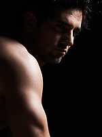 handsome caucasian sexy topless macho man portrait topless muscular in studio black background
