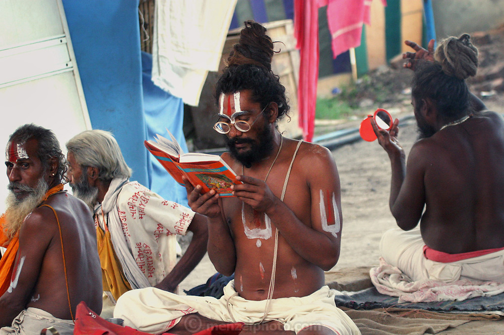 At an Ashram during Kumbh Mela in Ujjain, India. The man reading a book had taken a vow of silence and could not talk to us. The Kumbh Mela festival is a sacred Hindu pilgrimage held 4 times every 12 years, cycling between the cities of Allahabad, Nasik, Ujjain and Hardiwar. Kumbh Mela is one of the largest religious festivals on earth, attracting millions from all over India and the world. Past Melas have attracted up to 70 million visitors.
