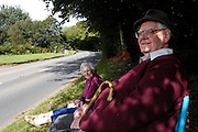UK, September 15 2011: Brian and Anne Horrell wait for the arrival of the riders on Woodbury Common during the fifth stage of the 2011 Tour of Britain. The stage started in Exeter and finished in Exmouth. Copyright 2011 Peter Horrell