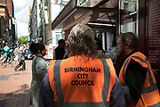 Birmingham City Council worker in high viz jacket in Birmingham, United Kingdom.