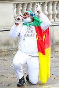 "A Cameroonian activist gestures as he protests in Whitehall, nearby Downing Street prior to French President Emanuel Macron's visit in London, on Thursday, June 18, 2020. They say France is involved in the looting of Cameroon and Africa. A letter addressing the press and members of the public says: ""We are here to tell Mr Macron this is unacceptable. Enough is enough!"".<br /> For his first foreign trip since lockdown, Emmanuel Macron will be in London to mark the 80th anniversary of de Gaulle's « appel de Londres », as well as cement Franco-UK ties at a strained time due to Brexit. (Photo/ Vudi Xhymshiti)"