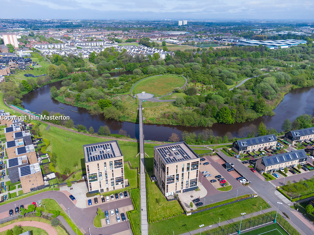 Aerial view of Cuningar Loop public woodland park and Athletes village modern housing  on banks of River Clyde at Rutherglen, Glasgow, Scotland, UK
