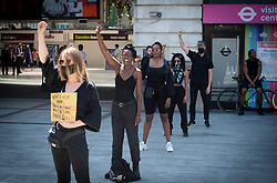 Black Lives Matter <br /> Protest outside Victoria Station, London, Great Britain <br /> 23rd June 2020 <br /> <br /> Together We Stand <br /> Say Her Name <br /> A call for women dressed in black to come together to stand for Belly Mujinga who worked as a ticket controller at Victoria station but died from Coronavirus after an incident that involved an irate passenger spitting at her, she had not been given PPE kit by her management. <br /> <br /> Protesters holding an 8 minute 46 second silence.  <br /> <br /> Photograph by Elliott Franks