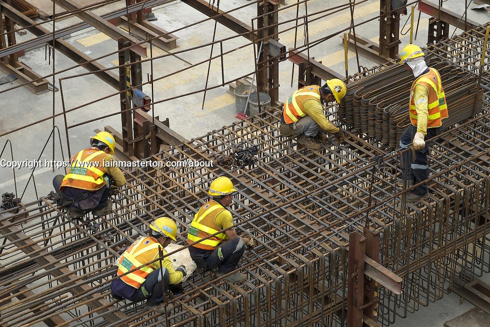 Steel fixers working on construction site in Central district of Hong Kong