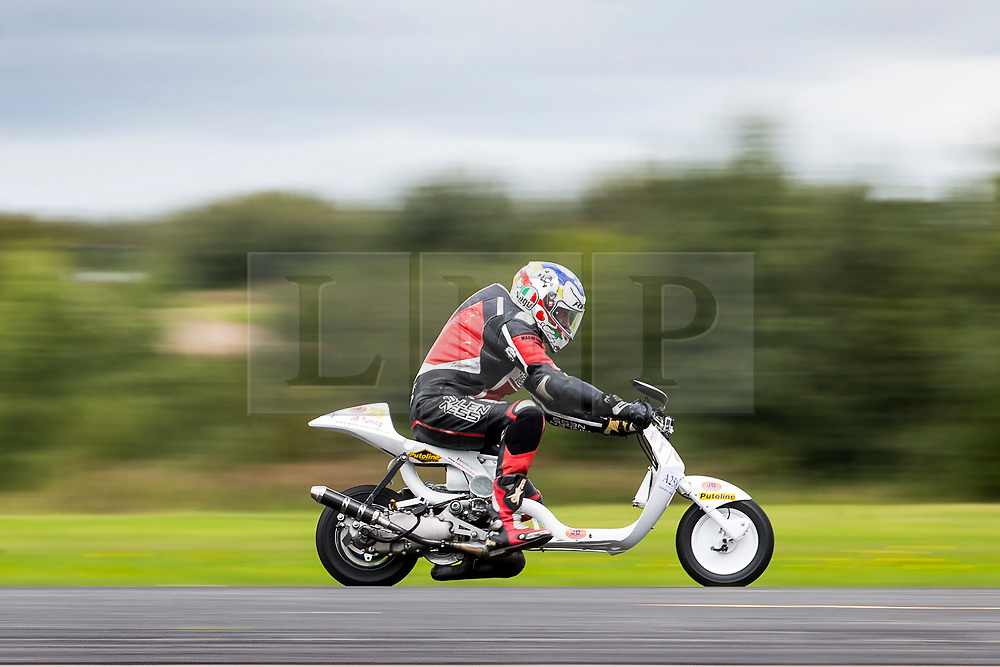 © Licensed to London News Pictures. 16/09/2017. York UK. Keith Terry races his 246cc Lambretta Kursaal along the runway at the Straighliners Top Speed weekend at Elvington airfield near York today. The eveny is similar to the famous Bonneville land speed events in the US only lower cost & more convenient for Europeans. Photo credit: Andrew McCaren/LNP