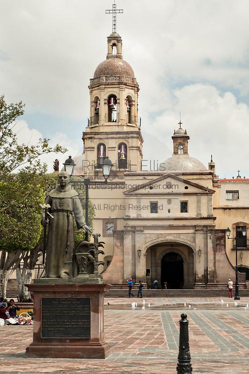 Statue of Friar Junipero Serra at the Holy Cross Church and Franciscan Convent also called the Templo y Convento de la Santa Cruz on Founders Plaza in the old colonial section of Santiago de Queretaro, Queretaro State, Mexico.