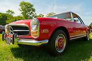 Old Westbury, New York, U.S. - June 1, 2014 -  A red 1969 Mercedes Benz, owned by LEONARD J HUMMEL of LLOYD HARBOR, is an entry at the Antique and Collectible Auto Show held on the historic grounds of elegant Old Westbury Gardens in Long Island, and sponsored by Greater New York Region AACA Antique Automobile Club of America.