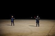 Forze dell'ordine all'Aeroporto Leonardo Da Vinci prima dell'arrivo dell'Air Force One. Fiumicino, Roma, 26 marzo 2014. Christian Mantuano / OneShot