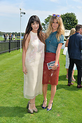 Left to right, ZARA MARTIN and JADE WILLIAMS at the Audi International Polo at Guards Polo Club, Windsor Great Park, Egham, Surrey on 26th July 2014.