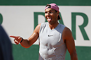 Rafael Nadal of Spain jokes with Iga Swiatek of Poland - they practice together 20 minutes - ahead of the French Open 2021, a Grand Slam tennis tournament at Roland-Garros stadium on May 29, 2021 in Paris, France - Photo Jean Catuffe / ProSportsImages / DPPI