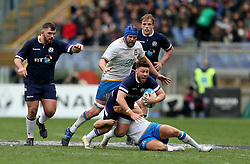 Scotland's Ali Price is tackled during the NatWest 6 Nations match at the Stadio Olimpico, Rome.