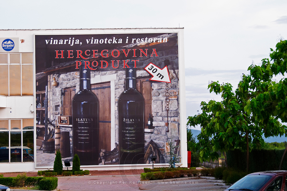 Advertising poster billboard on the outside of the winery. Hercegovina Produkt winery, Citluk, near Mostar. Federation Bosne i Hercegovine. Bosnia Herzegovina, Europe.
