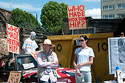 Buxton Street off Brick Lane, East London. June 8th 2014. Vauxhall Art Car Boot Fair. Stall promoting Factual Nonsense, and book of the same name, the biography of Joshua Compston who started the 'Fete worse than death' art fair in Hoxton 20 years ago.