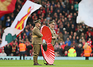 A giant red poppy is carried out onto the pitch for remembrance day  - Barclays Premier League - Liverpool vs Chelsea - Anfield Stadium - Liverpool - England - 8th November 2014  - Picture Simon Bellis/Sportimage