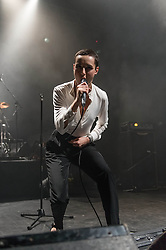 © Licensed to London News Pictures. 06/11/2013. London, UK.   Savages performing live at The Forum.  In this pic Jehnny Beth.  Savages are a London-based post-punk rock band composed of members Jehnny Beth (vocals, real name: Camille Berthomier), Gemma Thompson (guitar), Ayse Hassan (bass), Fay Milton (drums).  Photo credit : Richard Isaac/LNP