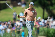 Jordan Spieth waves to the crowd after making a putt during the final round of the AT&T Byron Nelson in Las Colinas, Texas on May 31, 2015. (Cooper Neill for The New York Times)
