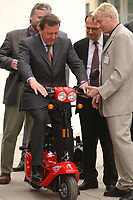 """11 APR 2002, MAGDEBURG/GERMANY:<br /> Gerhard Schroeder (M), SPD, Bundeskanzler, Reinhard Hoeppner (2.v.R.), SPD, Ministerpraesident Sachsen-Anhalt, und Thomas Neumann (R), Laboringenieur FB Gestaltung/Industriedesign, mit einem in der FH entworfenen Elektroroller """"Charlie"""" der MZ Motorradwerke, Besuch der Fachschule Magdeburg-Stendal<br /> IMAGE: 20020411-01-028<br /> KEYWORDS: Gerhard Schröder, Reinhard Höppner, Ministerpräsident, Motorroller, Roller"""