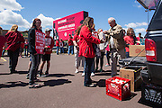 Pennsylvania State Representative David Millard (R - Columbia County) distributes food to striking Verizon workers near Bloomsburg.