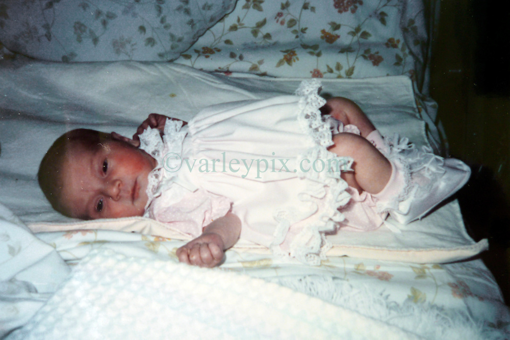 21 May 2015. Laurel, Mississippi.<br /> Collect photos of plus size model Tess Holliday (formerly known as Tess Munster, née Ryann Hoven) in her formative years from a family album. Tass at just a few months old.<br /> Photo credit; Tadlock via Varleypix.com