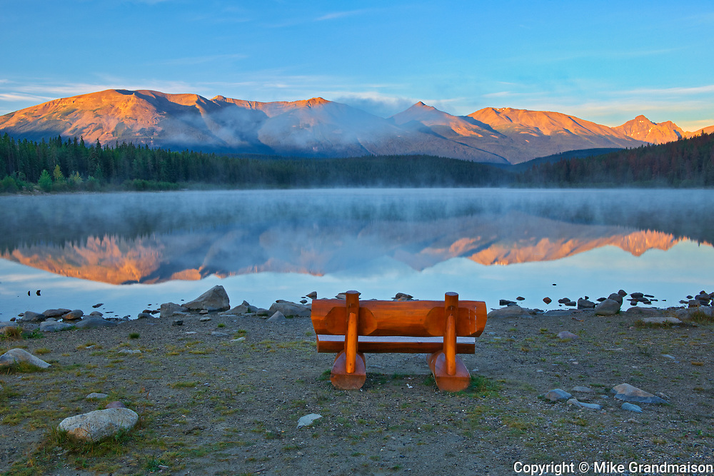 Bench overlooking Patricia Lake and the Trident Range of  the Canadian Rocky Mountains<br />Jasper National PArk<br />Alberta<br />Canada