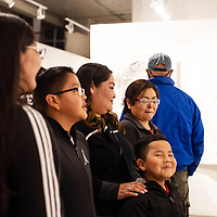 Myles Nabahe, 6, beams with pride as the family admires his aunt's, Lakota Begay, 16,  art work at the 5th Annual Youth Art Show at the ART123 Gallery in downtown Gallup Saturday evening.