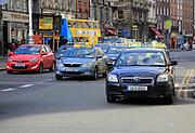 Taxis in traffic College Green, city centre of Dublin, Ireland, Irish republic