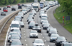 © Licensed to London News Pictures 28/05/2021. Swanley, UK. Traffic near Swanley in Kent. The May bank holiday getaway has started on the M25 in Kent with miles of queuing traffic Anti Clock-wise towards the Dartford Crossing. Millions of cars are expected on the roads this weekend as people make the most of the sunny weather with a weekend away to visit family and friends. Photo credit:Grant Falvey/LNP
