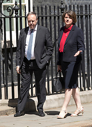 © Licensed to London News Pictures. 02/07/2018. London, UK. DUP Leader Arlene Foster and Nigel Dodds MP arrive in Downing Street for talks with Prime Minister Theresa May. Photo credit: Peter Macdiarmid/LNP