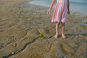 Australian tourist child (5 years old) standing on beach. Sanur, Bali, Indonesia.