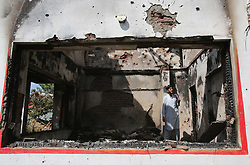 June 22, 2017 - Awantipora, Kashmir - A Kashmiri man looks inside a burnt house after a gunfight at village Kakapora in Pulwama district, about 25 km south of Srinagar city, the summer capital of Indian-controlled Kashmir. Three militants belonging to Lashkar-e-Toiba (LeT) militant outfit were killed Thursday in a fierce gunfight with troops in restive Indian-controlled Kashmir, officials said. (Credit Image: © Javed Dar/Xinhua via ZUMA Wire)