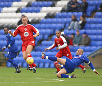 Photo: Jo Caird<br />Peterborough v Bristol city<br /><br />Nationwide Div 2 2004<br />14/02/2004.<br /><br />Brian Tinnion dodges Boro's curts woodhouse