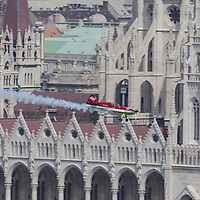 Aerobatic european champion Zoltan Veres of Hungary flies in front of Hungarian Parliament with his airplane during an air show above river Danube crossing central Budapest, Hungary on May 01, 2013. ATTILA VOLGYI