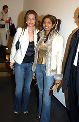 Left to right, LAURA PIGORINI and DIVIA LALVANI at an exhibition of photographs by Matthew Mellon entitled Famous Feet - featuring well known people wearing shoes from Harrys of London, held at Hamiltons Gallery, Carlos Place, London on 22nd November 2004.<br /><br />NON EXCLUSIVE - WORLD RIGHTS