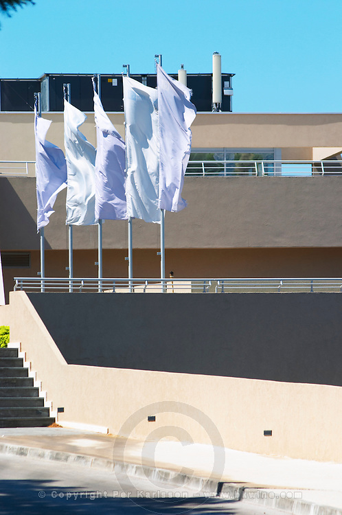 White flags flipping in the wind outside the luxury hotel Dubrovnik Palace. Uvala Sumartin bay between Babin Kuk and Lapad peninsulas. Dubrovnik, new city. Dalmatian Coast, Croatia, Europe.