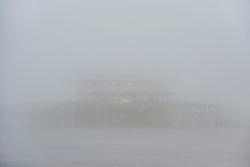 © London News Pictures. 24/09/2013 . Brighton, UK.  The old Brighton Pier shrouded in fog early morning on the day Ed MIliband makes his keynote speech at the 2013 Labour Party Conference in Brighton. . Photo credit : Ben Cawthra/LNP