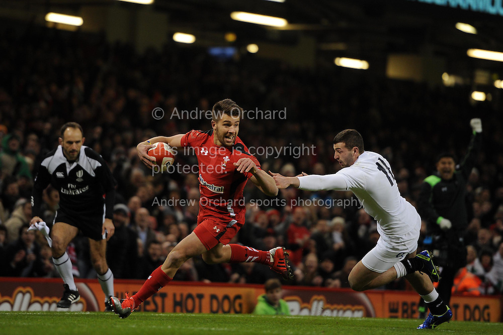 Rhys Webb of Wales runs in to score the 1st try.  RBS Six nations championship 2015, Wales v England at the Millennium Stadium in Cardiff, South Wales on Friday 6th  Feb 2015. pic by Andrew Orchard, Andrew Orchard sports photography.