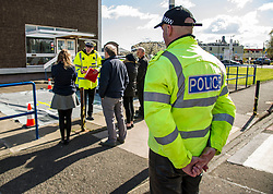 Pictured: PC Dominic Doyle is leading on the training of offenders and is seen discussing road use with four drivers this morning<br /> <br /> A new policing initiative to promote cycle safety was launched in Edinburgh today. The operation saw drivers pulled over for passing too close to an unmarked police cyclist or any other vehicle.<br /> Ger Harley | EEm 24 April 2017