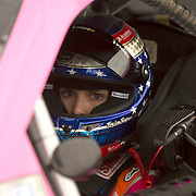 Danica Patrick, driver of the Florida Lottery Chevrolet, sits in her car during a weather delay during the qualifying practice session of the NASCAR Nationwide Drive4COPD 300 at Daytona International Speedway on Friday, February 21, 2014 in Daytona Beach, Florida.  (AP Photo/Alex Menendez)