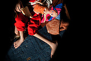 Mariam, 7, a girl suffering from a severe neurological disorder, is playing with her doll in her home in Fallujah, Iraq. The family has three children affected by severe illnesses, all born after the 2004 US-led battles for the city. The family and their relatives have no history of birth defects.