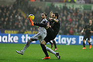 Manchester city's Alvaro Negredo is stopped by Swansea city's Chico Flores.Barclays Premier league, Swansea city v Manchester City at the Liberty Stadium in Swansea,  South Wales on  New years day Wed 1st Jan 2014 <br /> pic by Andrew Orchard, Andrew Orchard sports photography.