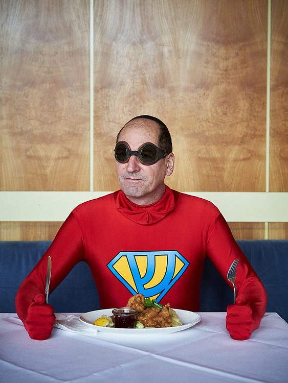 Germany, Berlin, 2018/02/19<br /> <br /> Artist Joachim Seinfeld sits for a portrait in one of his costumes /Jewish Superhero) at the cantina of Funkhaus Berlin. Mr Seinfeld uses costumes to reeanct historic photographs.